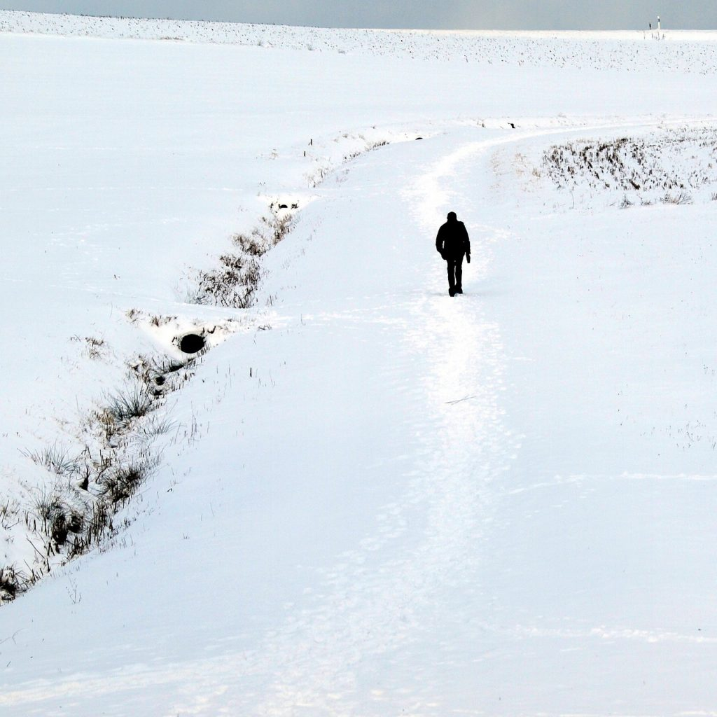 Man walking through the snow