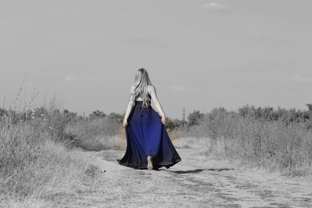 Girl in a dress walking on a path