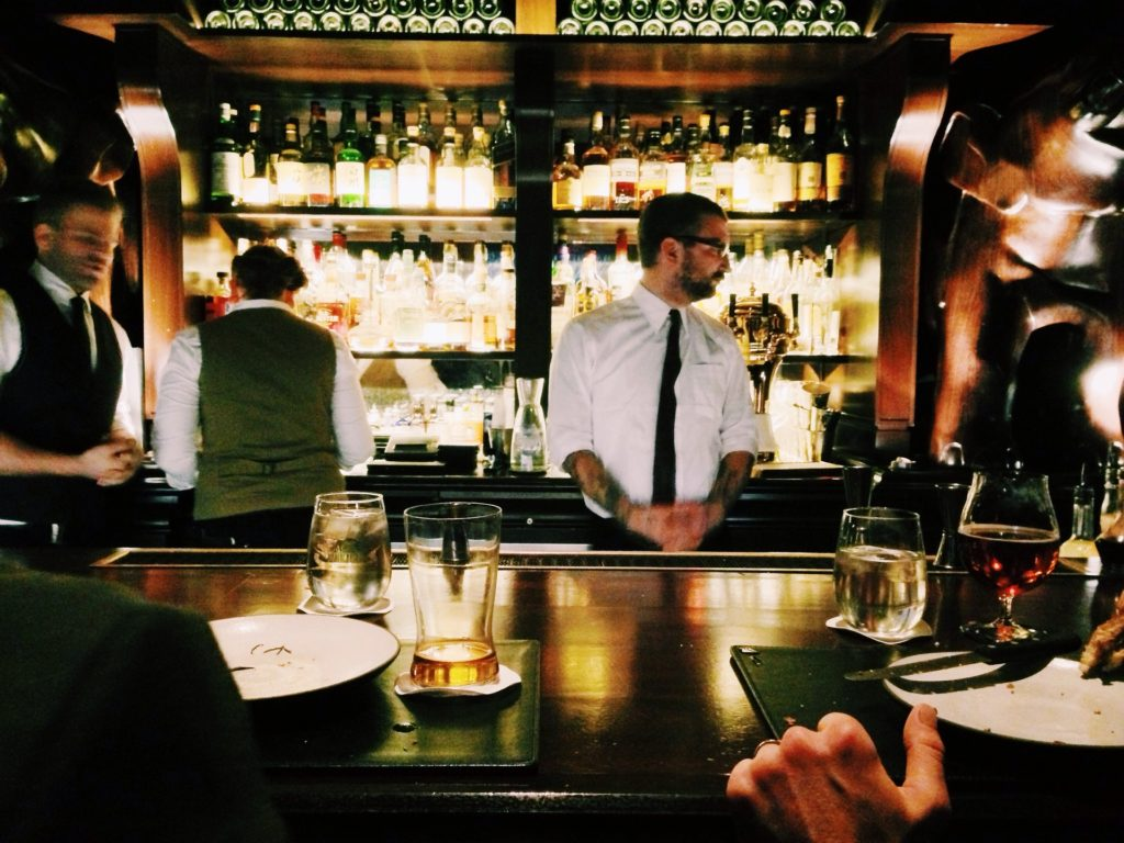 Bar with waiters and drinkers