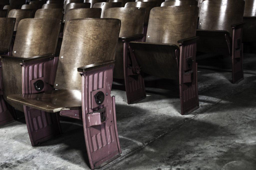 Folding theatre seats row