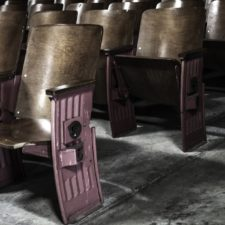 Folding theatre seats row