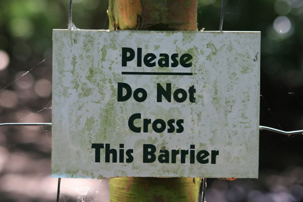 Sign, 'Please do not cross this barrier'